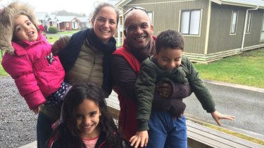 Reunited: Former Nauru opposition MP Roland Kun with his Australian wife Katy Le Roy and their three children.