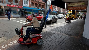 A man rides an electric mobility scooter in Sydney.