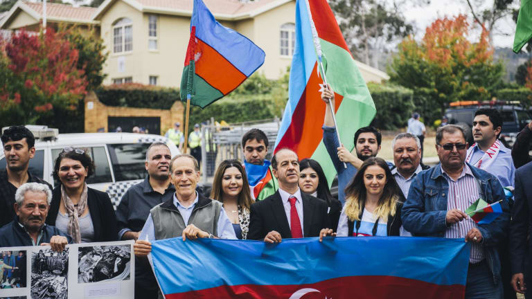 Azerbaijan supporters with flags outside the Azerbaijan Embassy in O'Malley.