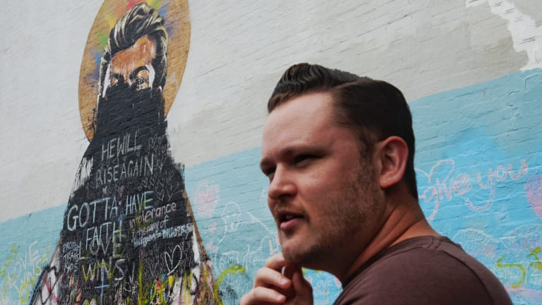 Local cartoonist Edmund Iffland is upset about the continuing vandalism of the <i>St. George </i> mural.