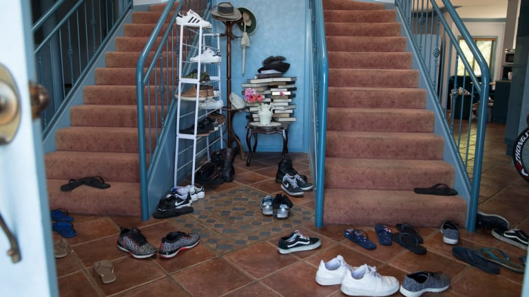 Shoes in the foyer of one of many properties rented by Frank Lin and turned into boarding houses for Taiwanese nationals who are working at the nearby Thomas Foods plant.