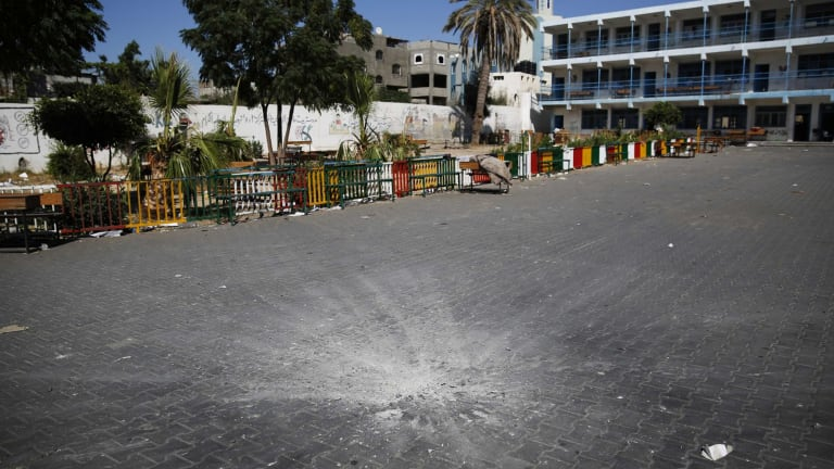 A crater from a shell in the courtyard of the school.