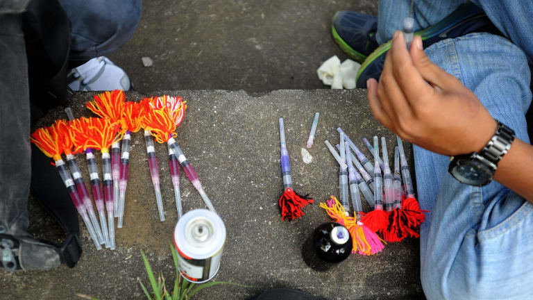 Strychnine-laced darts being prepared for the dog elimination.