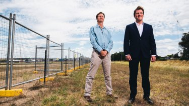 Foy's Bevan Dooley and Stuart Clark at the site of the proposed plastics-to-fuel factory in Hume, now rejected by the ACT government.