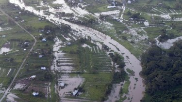 An aerial view from the Royal Austalian Air Force C-17A Globemaster aircraft revealing widespread floods in Fiji caused by Tropical Cyclone Winston.