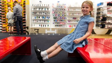 Asha Taylor tries on new school shoes at Shoes & Sox, in Bondi Junction, Sydney.