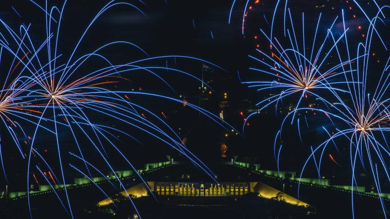 Fireworks frame Parliament House.