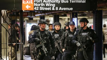 Police officers patrol the Port Authority bus terminal following the explosion.
