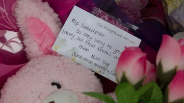 Tributes are left where the body of 15-month-old Sanaya Sahib was found in nearby Darebin Creek.