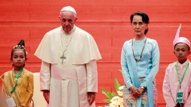 Myanmar's leader Aung San Suu Kyi, centre right, and Pope Francis pose for media in Naypyitaw.