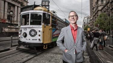 Artist Jon Campbell, seen in 2013 with one of his designs for an art tram.