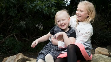 For the past four years, Evie, left has been taking powerful drugs and undergoing neurosurgery and chemotherapy to beat the cancer.