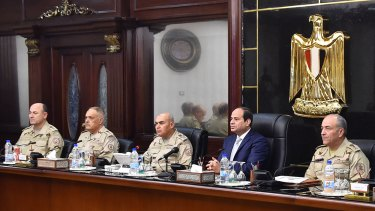 Egyptian President Abdel Fattah al-Sisi, second right, chairs a meeting of the Supreme Council of the Egyptian Armed Forces in Cairo last year.