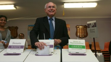 John Howard casts his vote in the 2007 election that would see him thrown out of office and his own Sydney seat.