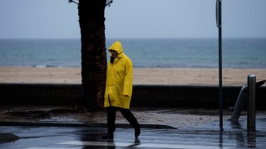 A woman rugged-up at Altona Beach, Melbourne, on Sunday/