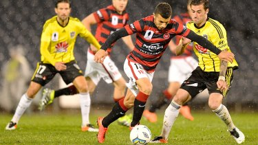 Jaushua Sotirio of the Wanderers gets on the front foot against Phoenix.