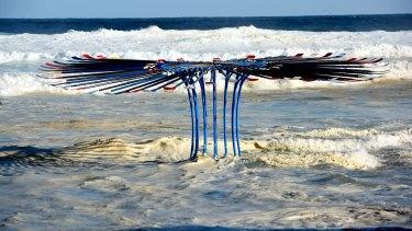 King tide surrounds a sculpture by Rebecca Rose at Tamarama Beach.
