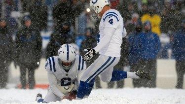 Indianapolis Colts kicker Adam Vinatieri  kicks the tying point.
