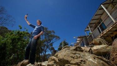 Brendan Hehir checks for a mobile phone signal at his Blackwood house.