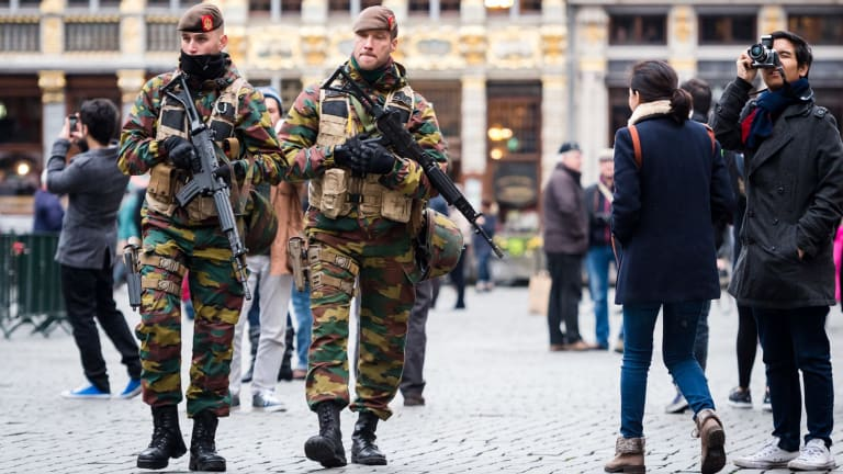 Belgian Army soldiers patrol in the picturesque Grand Place in the centre Brussels. An international manhunt for Belgian-born Paris attack suspect Salah Abdeslam continues.