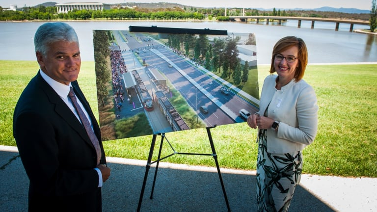 Minister for Transport Meegan Fitzharris, right, and light rail project director Scott Lyall open tenders for the Woden light rail line, which will travel across Commonwealth Avenue bridge.