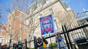 Demonstrators in front of the Russian Ambassador's Residence in Washington during a 'Not My President's Day' rally on February 20.