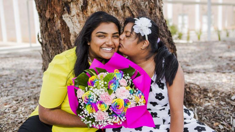Nipuni Wijewickrema and her sister Gayana who has Down syndrome.