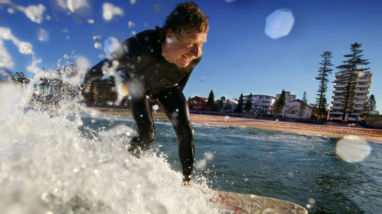 Midget Farrelly surfs at Manly Beach 40 years after winning the first World Surfing Championships held there in 1964.