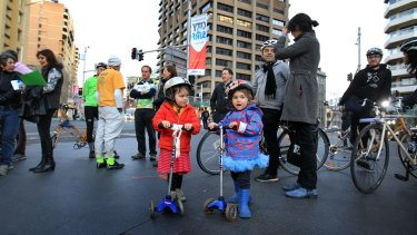 Youngsters at a protest by cyclists against government moves to remove a cycleway in Sydney.