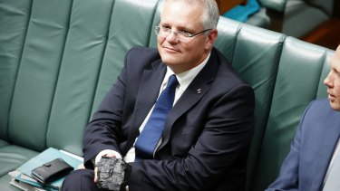 Treasurer Scott Morrison with a lump of coal during Question Time this week.