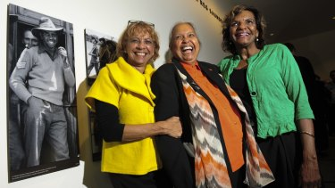 Captain Reg Saunders' daughters Dorothy Burton, Glenda Humes and Judith Standen inside the gallery named after their father.