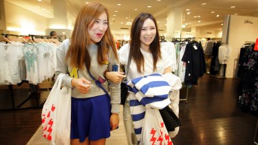 Joyce Tang and Wendy Lin enjoy the sales at the David Jones city store in Sydney.