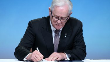 Australia's Minister of Trade and Investment Andrew Robb signs the Trans Pacific Partnership in Auckland, New Zealand, last week.