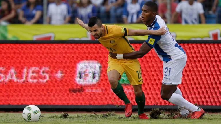 Australia's Aziz Behich fights for the ball in San Pedro Sula.