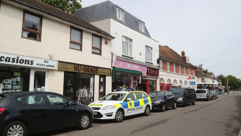 Police activity at a property in Shoreham-by-Sea, England,  where a 23-year-old man was arrested on Monday.