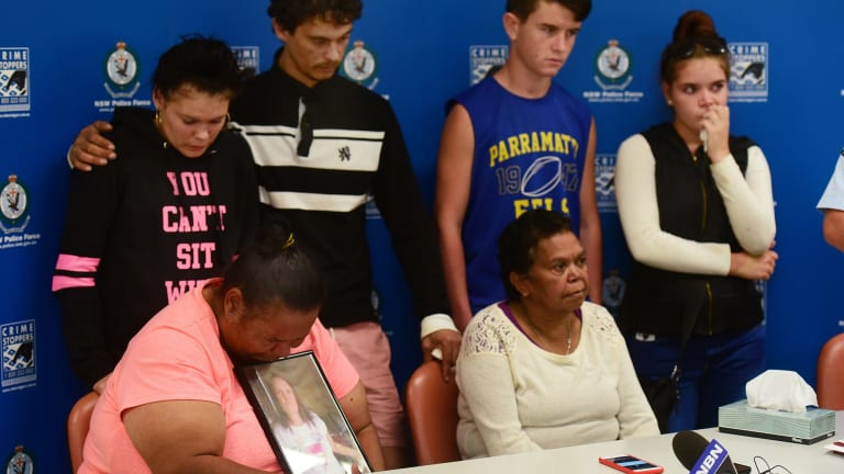 Johann Morgan's four children at the rear, Tamika, Michael, Steven and Rhonda Morgan with Inspector Phil O'Reilly and, Johann's sisters, Vivienne and Yvonne seated), plead for information to find the missing mother.