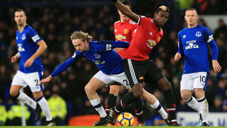 Everton's Tom Davies and Manchester United's Paul Pogba battle for the ball.