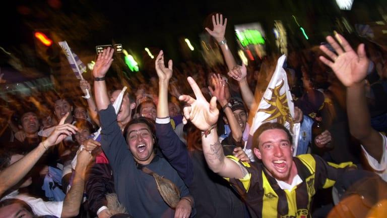 Uruguayan soccer fans celebrate in downtown Montevideo in 2001.