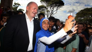 Sir Peter Cosgrove, Governor General of Australia, poses for a selfie with Danielle Rifahi from Parramatta West School on Australia Day.