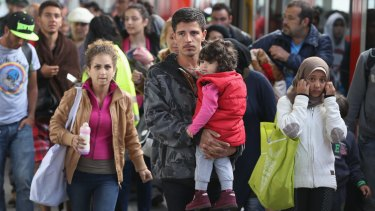 Migrants who had arrived from Hungary arrive to be led by police to a registration center in Munich, Germany.
