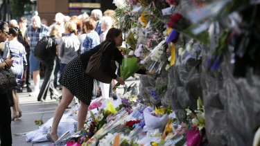 Remembering victims: Floral tributes continued to be left at Martin Place on Wednesday.