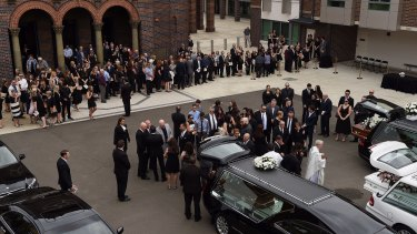 The crowd gathers outside the church after the funeral of Annabelle Falkholt and her parents Lars and Vivian Falkholt at St Mary's Catholic Church, Concord, Sydney.