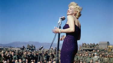 Marilyn Monroe singing to the troops in Korea in 1954. She made the trip as part of her honeymoon with Joe DiMaggio.