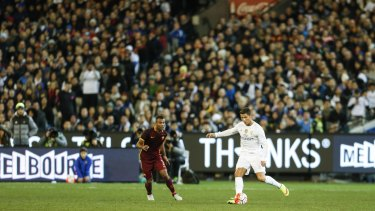 Global icon: Cristiano Ronaldo controls the ball in front of a packed crowd at the MCG.