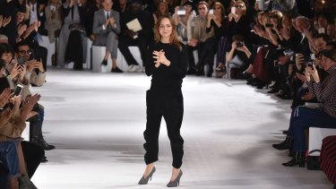 Stella McCartney accepts applause after her show at Paris Fashion Week on Monday.