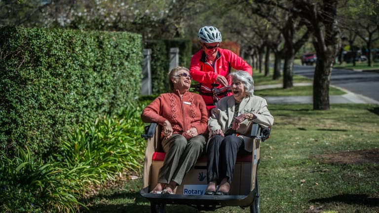 Adrienne Capp, 80 and Beryl Hunter, 99, piloted by Caroline Fargher of Pedal Power.
