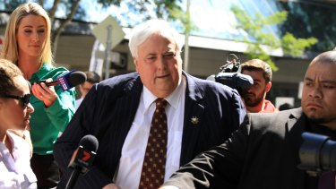 Mr Palmer's security has again clashed with media as the businessman fronted Federal Court on Monday.