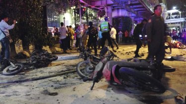 Motorcycles are strewn about after an explosion at a central Bangkok intersection during the evening rush hour, killing a number of people and injuring others, police said.