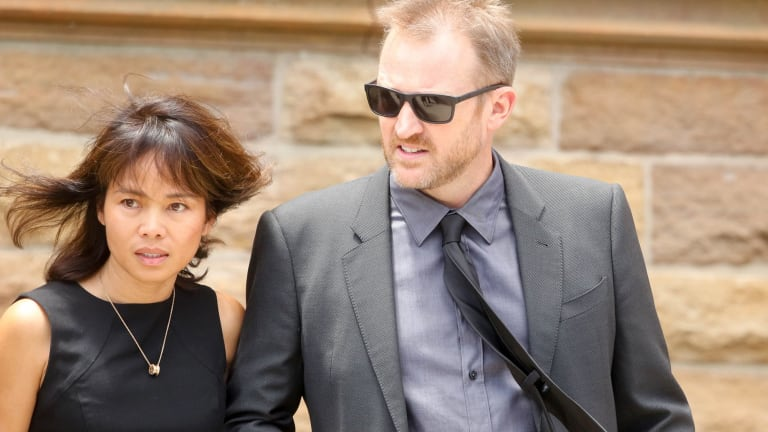 Owner of Sydney Seaplanes Aaron Shaw and his partner leave the funeral of pilot Gareth Morgan.