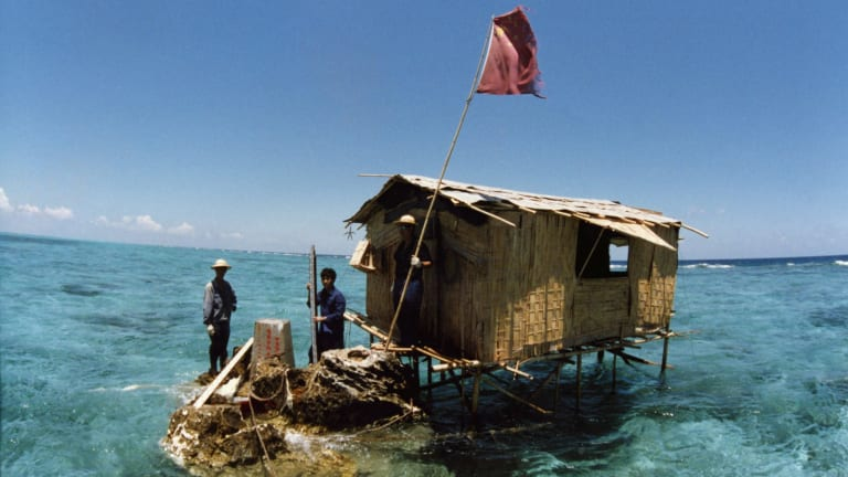 China's activity in the South China Sea has accelerated in recent years. Pictured is a Chinese outpost on Nanxun Reef in the Spratly Islands in 1988.